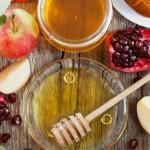 Rosh Hashana, Jewish New Year Holiday, Honey, apple, pomegranate, hala on a wooden table