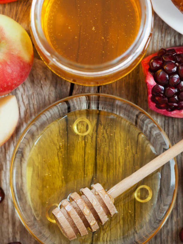 Rosh Hashana, Jewish New Year Holiday, Honey, apple, pomegranate, hala on a wooden table